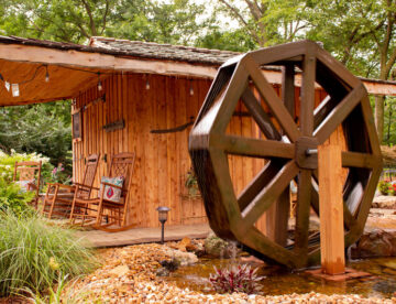 Peaceful nature waterwheel next to cedar cabin